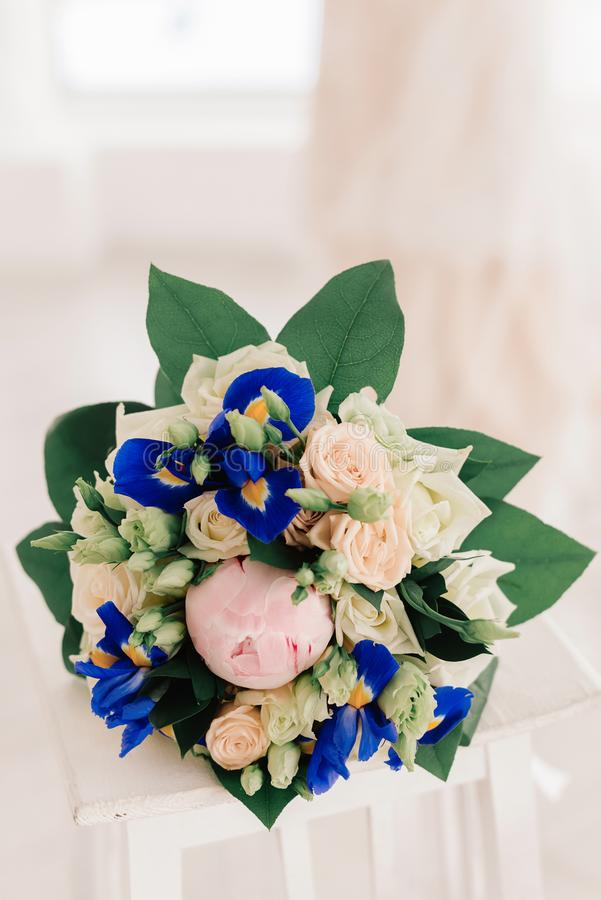 Wedding bouquet with blue flowers. Bouquet for the bride. Flowers for a beautiful woman royalty free stock photos
