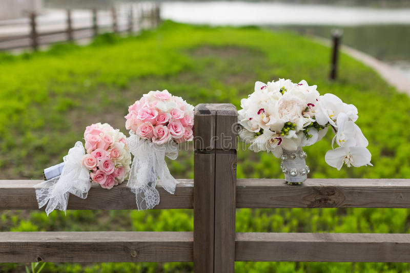 Wedding bouquet. S on the fence stock images