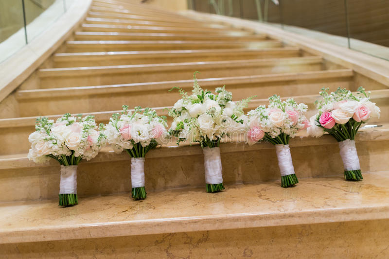 Wedding bouquet. S on the stair stock photo