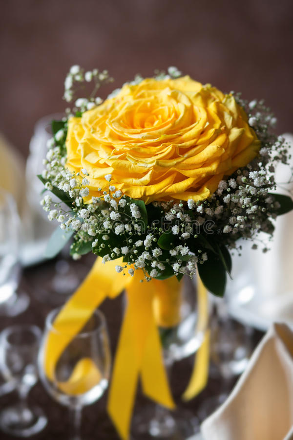 Wedding bouquet of the bride. bouquet flower big rose assembled from a large number of roses petals. decorated with baby. `s breath. is on the table in a vase royalty free stock photography