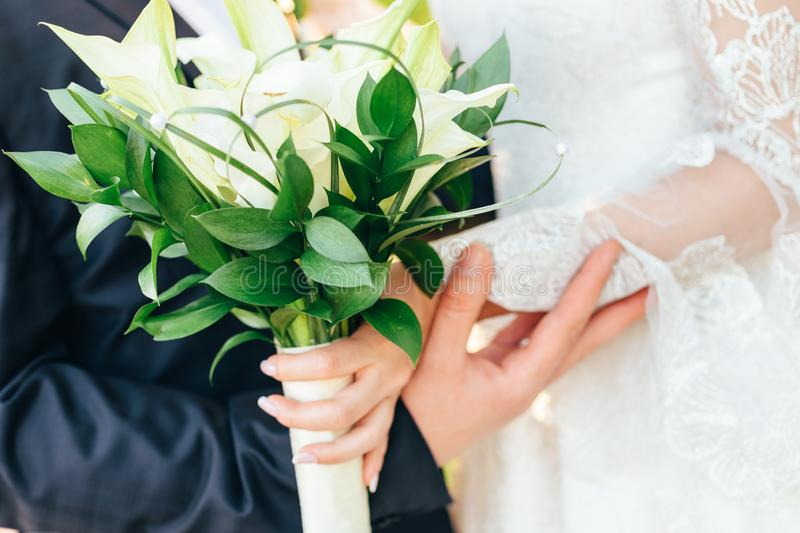 Wedding bouquet, bride and groom. wedding bouquet in the hands of the bride and groom stock images