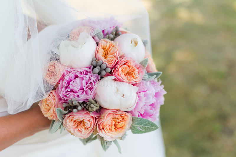 Wedding bouquet of the bride. In hand stock images