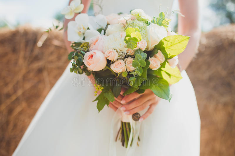 Wedding bouquet of the bride. In nature royalty free stock photography