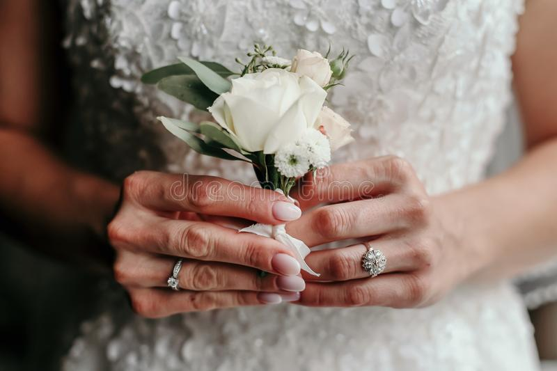 Wedding bouquet in bride`s hands stock photography