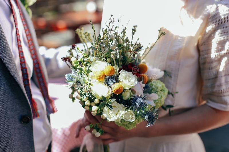 Wedding bouquet in bride`s hands stock photo