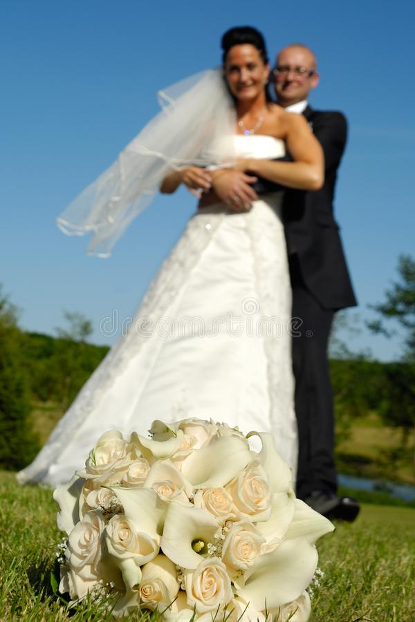 Wedding bouquet and couple stock photography