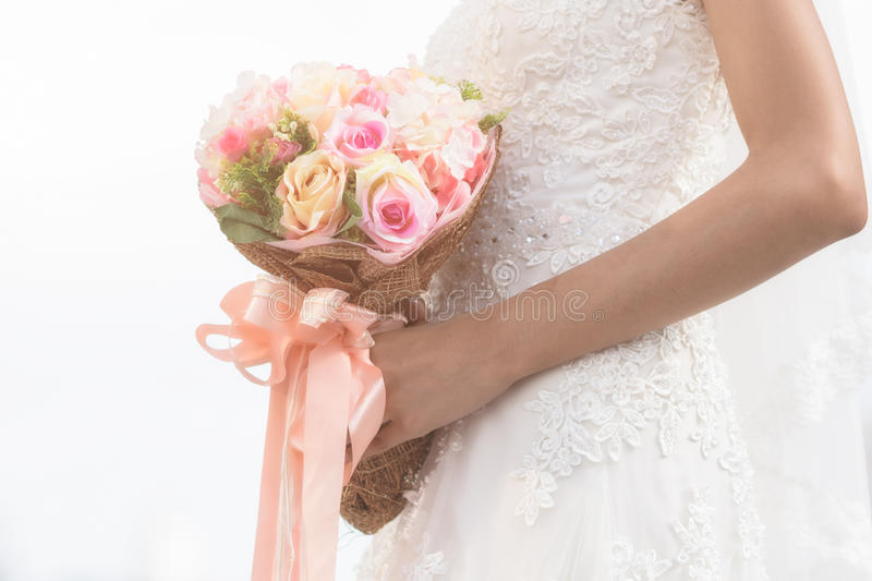 wedding bouquet with the flower in hands royalty free stock images