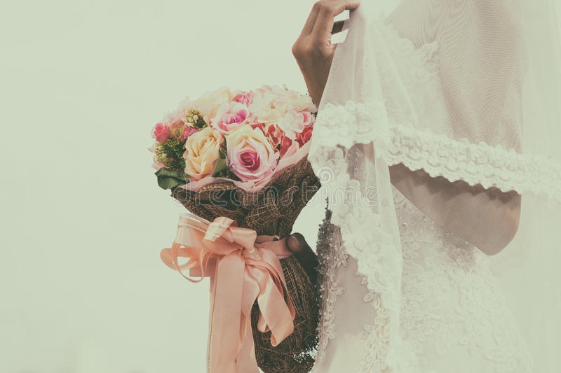 Wedding bouquet with the flower in hands stock images