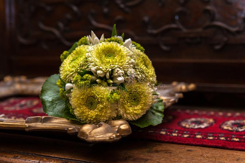 Wedding bouquet on a golden picture frame royalty free stock images