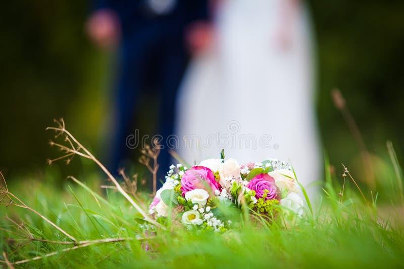 Wedding Bouquet in green grass meadow stock photo