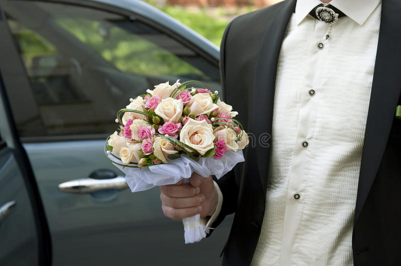 Wedding Bouquet in a Groom's Hand stock photo