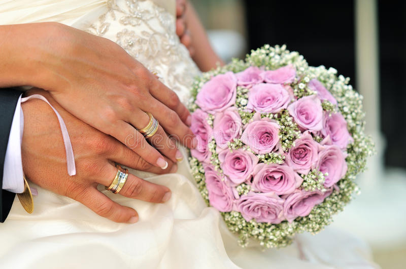 Wedding bouquet with hands royalty free stock photo