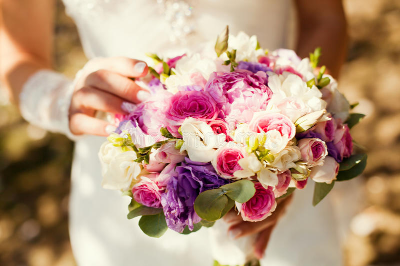 Wedding bouquet. In the hands stock photography