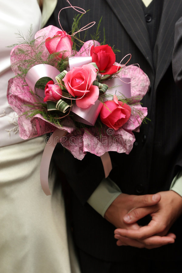 Wedding bouquet and hands stock image