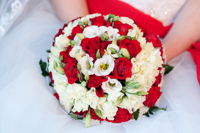 Wedding Bouquet In Hands Of The Bride. White And Red Roses Stock Photo