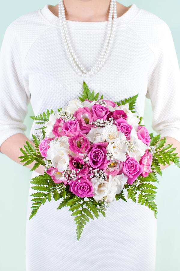 Wedding bouquet held by the bride stock photo