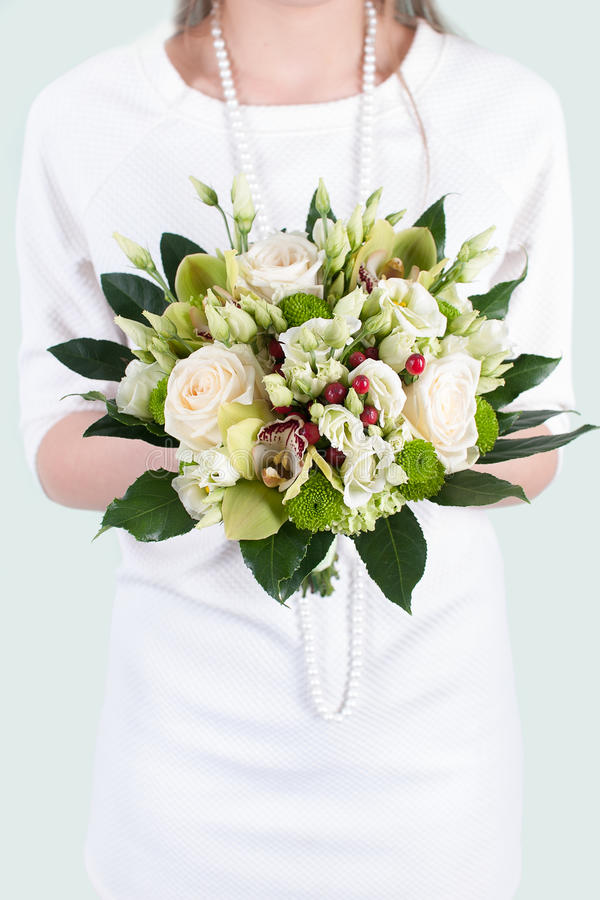Wedding bouquet held by the bride stock images