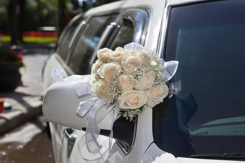 Wedding Bouquet on Limo. Wedding car decorated with flower bouquet stock photos