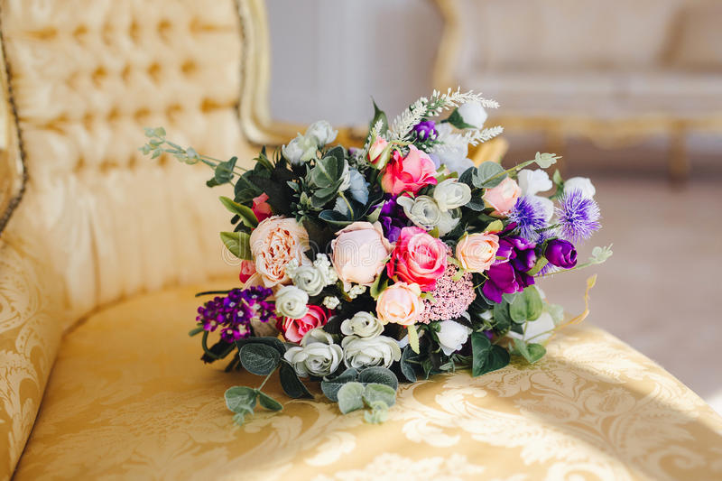 Wedding bouquet. Lying on the couch stock photos