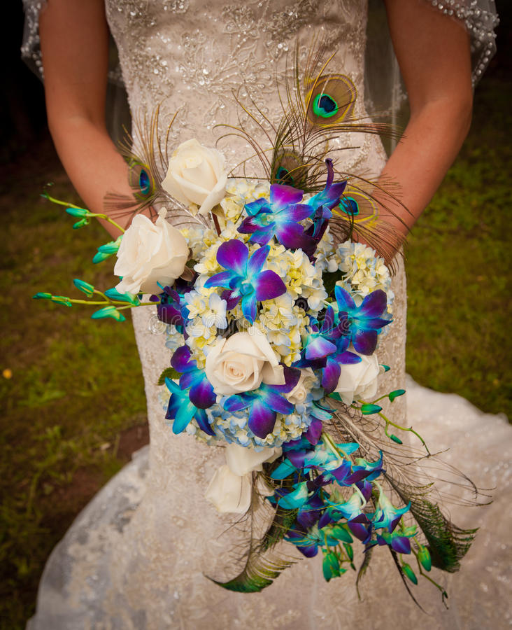 Wedding Bridal bouquet. Wedding bouquet with flowers and peacock feathers royalty free stock photo