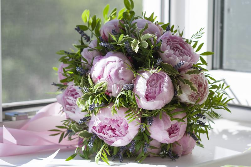 Wedding bouquet of pink peonies by the window royalty free stock photos