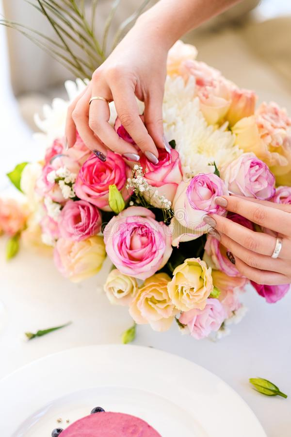 Wedding bouquet preparation florist job royalty free stock photo