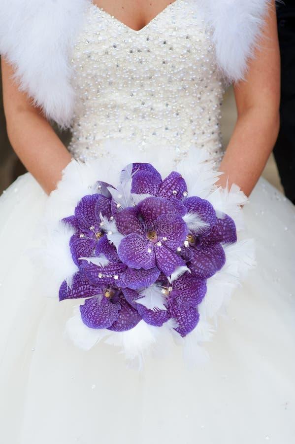 Wedding bouquet of purple orchids stock photos
