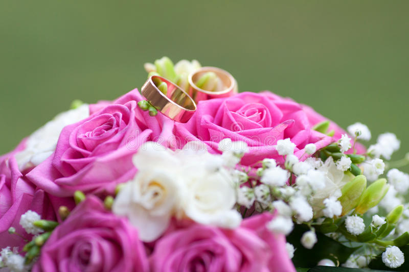 Wedding bouquet and rings. The wedding bouquet and rings royalty free stock photography
