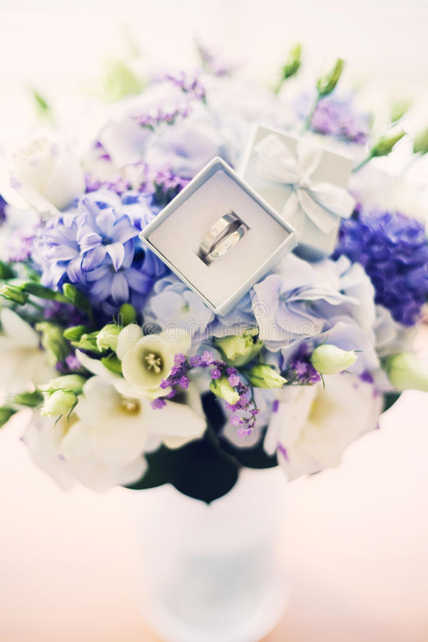 Wedding bouquet with rings. High key shot royalty free stock image