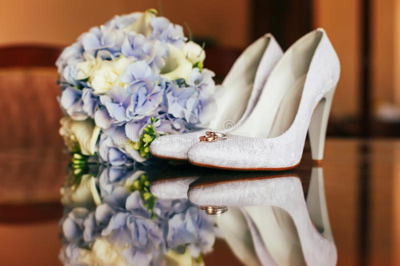 Wedding bouquet, rings and shoes royalty free stock photos