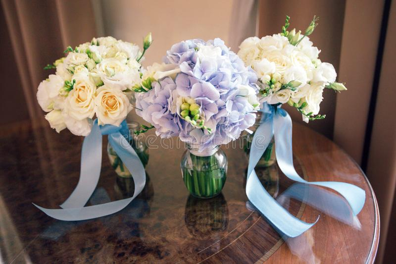 Wedding bouquet, rings and shoes. Details for marriage and for married couple stock photography
