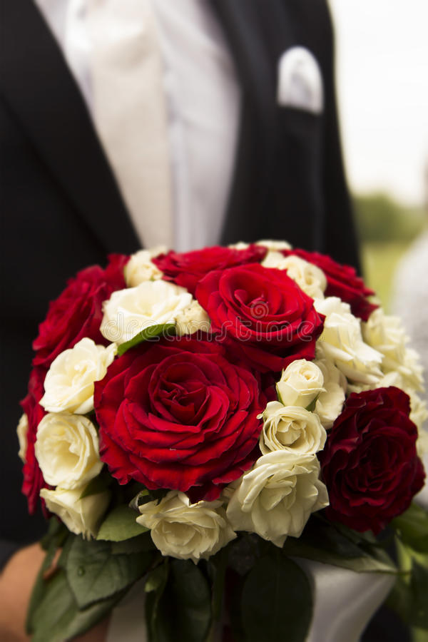 Wedding bouquet of roses. Beautiful wedding bouquet of roses stock photo