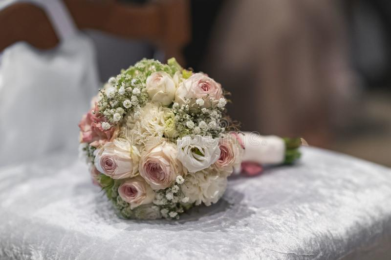Wedding bouquet of roses and other flowers lying on a bench royalty free stock images