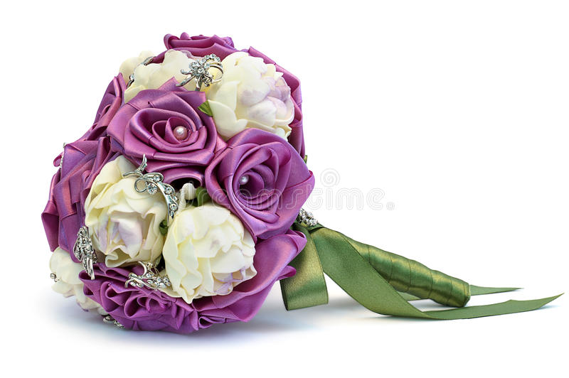 Wedding bouquet. Satin wedding bouquet with artificial flowers and pearls royalty free stock photos