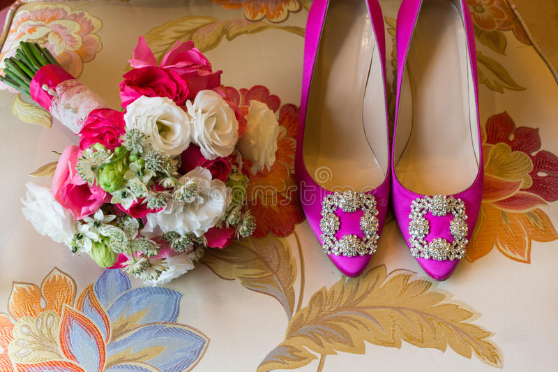 Wedding bouquet. And wedding shoes royalty free stock photography