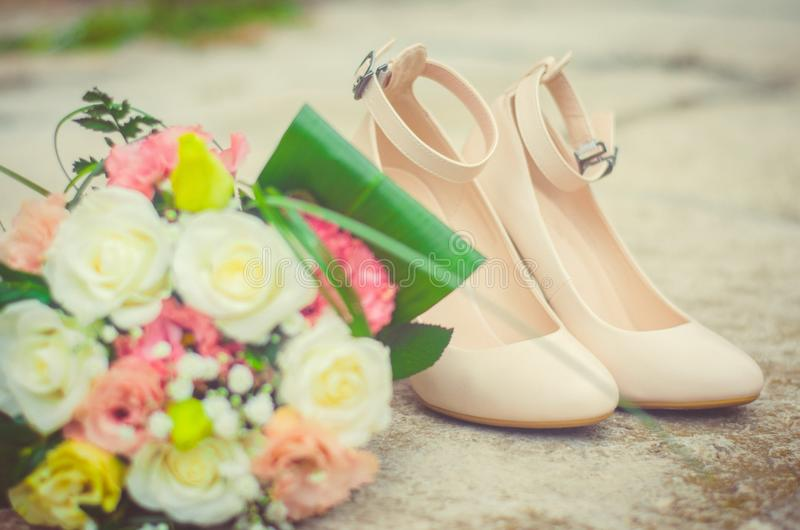 Wedding bouquet and shoes, details of the wedding, wedding, groom, bride. Wedding bouquet and shoes, details and accessories of wedding, wedding, groom, bride royalty free stock photography