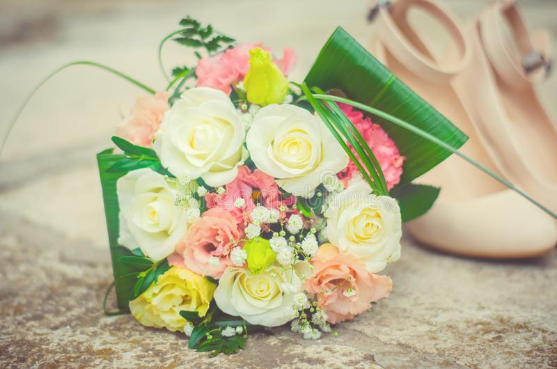 Wedding bouquet and shoes, details of the wedding, wedding, groom, bride stock image