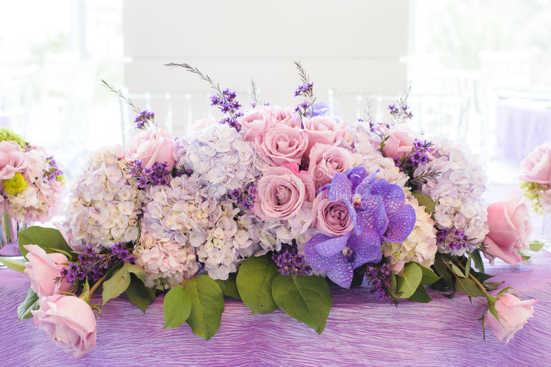 Wedding bouquet on table. Closeup of colorful wedding bouquet on lilac table at wedding reception stock image