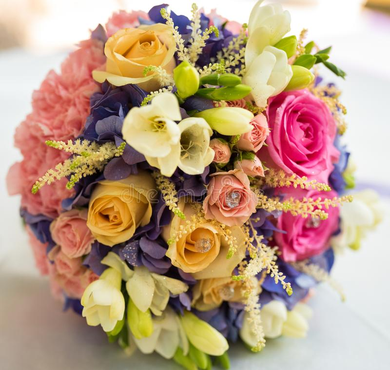 A wedding bouquet with a variety of flowers and lots of colors royalty free stock images