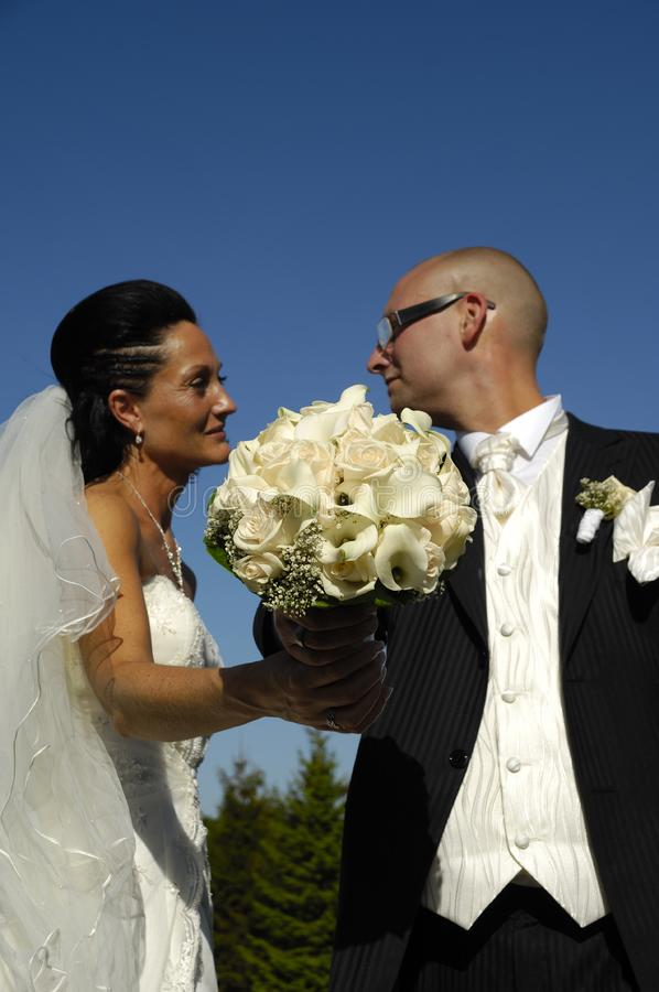 Wedding bouquet and wedding couple stock photography
