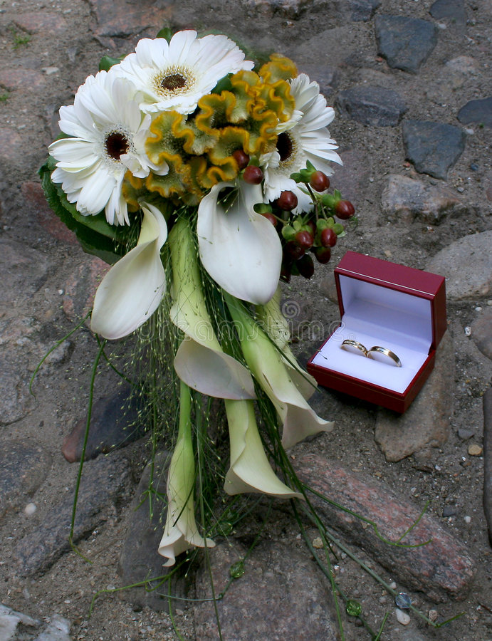 Wedding bouquet and wedding rings stock images