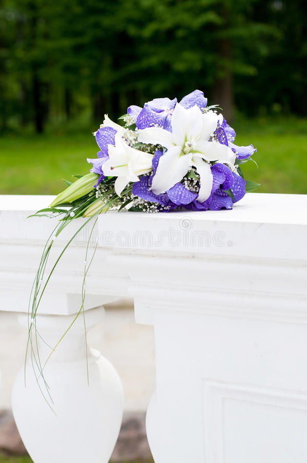 Wedding Bouquet with white and violet flowers. Outdoor
