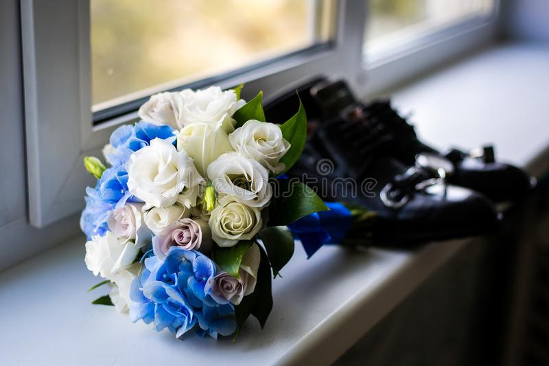 Wedding bouquet by the window.the attributes of the groom. newly married couple. the preparations of the groom stock photography