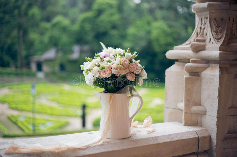 Wedding bouquet on the window of the old castle stock photos