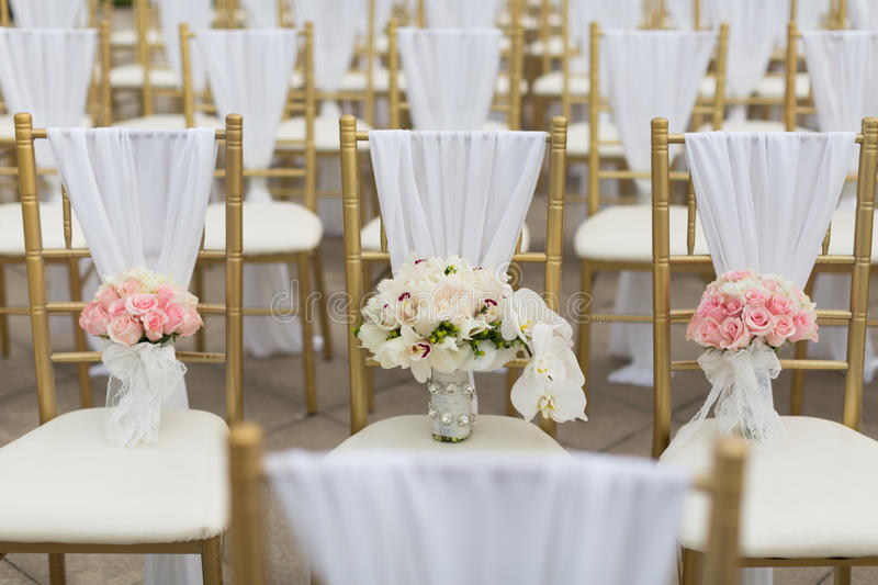 Wedding bouquets. On wedding chairs stock photos