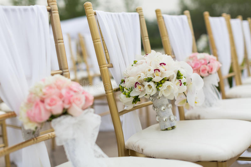 Wedding bouquets. On wedding chairs stock photography