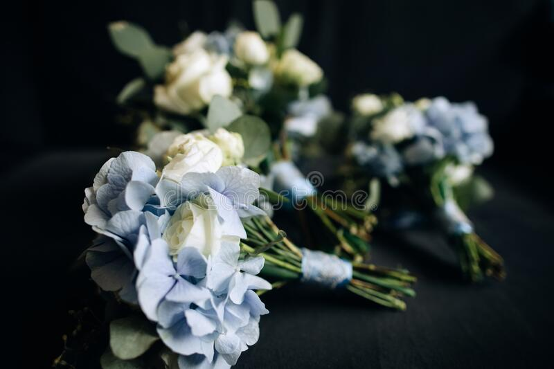 Wedding bouquets for friends of the bride of blue and white flowers. Beautiful Wedding bouquets for friends of the bride of blue and white flowers stock photo