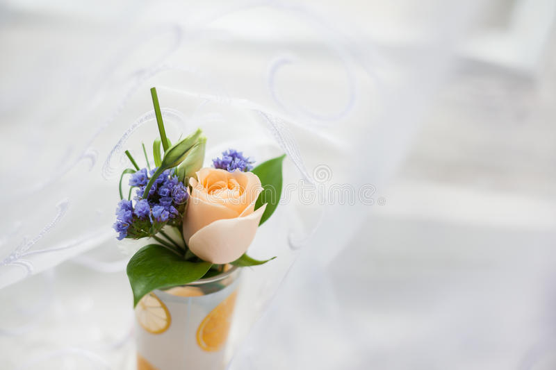 Wedding boutonniere in the glass royalty free stock photography