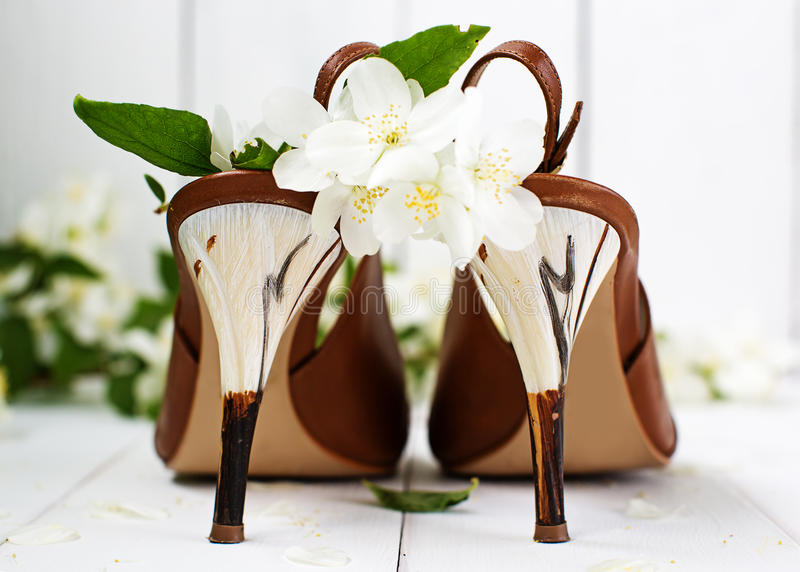 Wedding bridal fashion image. Shoes and flowers royalty free stock image