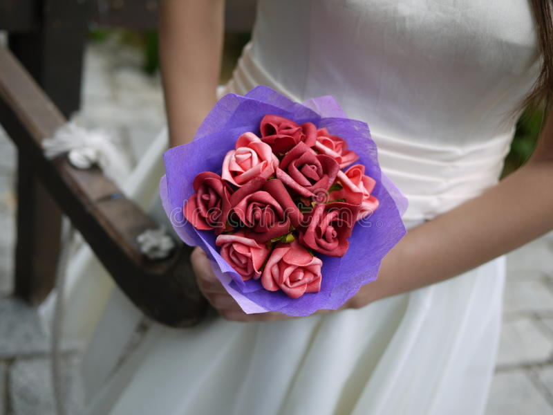 Wedding Bride. A bride holding a bouquet of flowers at her wedding stock photo